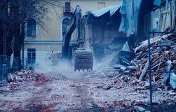 The demolition of building, excavator in work, destruction Stock Image