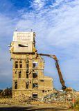 Demolition of a building with excavators Stock Images