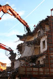 Demolition. Of building structure with heavy machines royalty free stock image