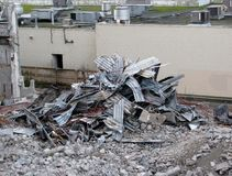 Demolition of building in urban environments. Stock Photo
