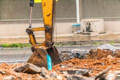 Demolition of buildings. Having to use a machine such as the backhoe to demolish can save time and save human labor Royalty Free Stock Photo