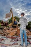 Demolition of buildings. Having to use a machine such as the backhoe to demolish can save time and save human labor Royalty Free Stock Images