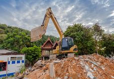 Demolition of buildings. Having to use a machine such as the backhoe to demolish can save time and save human labor Stock Photo