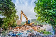 Demolition of buildings. Having to use a machine such as the backhoe to demolish can save time and save human labor Royalty Free Stock Photos