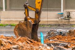 Demolition of buildings. Having to use a machine such as the backhoe to demolish can save time and save human labor Royalty Free Stock Image