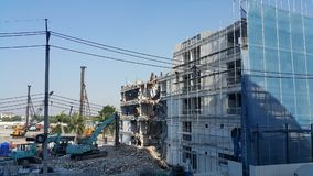 Demolition of buildings. One building demolition To build a new building Royalty Free Stock Images