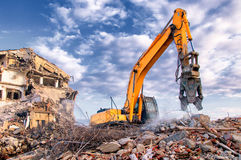 Demolition of buildings in urban. Environments with heavy machinery Stock Photo
