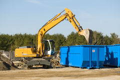 Demolition bulldozer. Yellow demolition bulldozer beside a dumpster Stock Photography