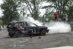 Demolition derby. Napierville demolition derby, July 12, 2015, picture of wrecked car making a smoke show during the demolition derby royalty free stock photography