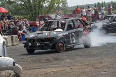 Demolition derby. Napierville demolition derby, July 12, 2015, picture of wrecked car making a burnout during the demolition derby royalty free stock images