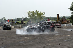 Demolition derby. Napierville demolition derby, July 12, 2015, picture of demolition car in action making a smoke show during the demolition derby stock photos