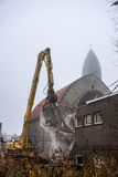 Demolition of church with falling rubble and dust Stock Photography