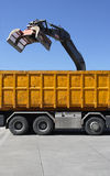 Demolition claw. Dumping material into a waiting truck Royalty Free Stock Photos