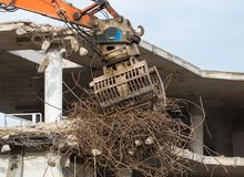 Demolition of a concrete building. Demolition of a building with concrete floors and pillars Stock Image
