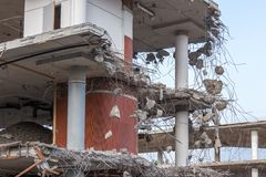 Demolition of a concrete building. Demolition of a building with concrete floors and pillars Stock Photos