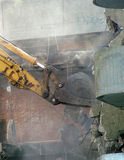 Demolition of concrete using a digger Stock Photography