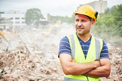 Demolition construction work. Worker at building site royalty free stock photos
