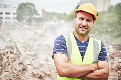 Demolition construction work. Worker at building site stock photos