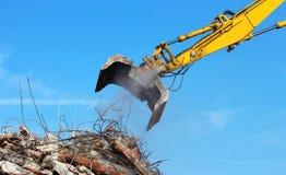 Demolition crane. Dismantling a building stock image