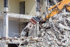 Demolition crane dismantling a building Stock Photography