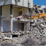 Demolition crane dismantling a building Royalty Free Stock Photography