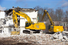 Demolition crane dismantling. Demolition cranes dismantling a building Royalty Free Stock Photo
