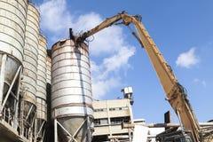 Demolition crane dismantling old tanks Royalty Free Stock Images