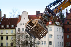 Demolition crane in front of the old town Stock Image