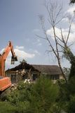 Demolition Crane starts taking down my neighbors house Stock Photography