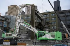 Seattle Viaduct demolition Jaws will chomp. Demolition crews removing Seattle`s Viaduct in the Pioneer square neighborhood. March 27 2019 stock images