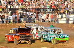 Demolition Derby. UFA, RUSSIA - AUGUST 1: Undefined competitors' Moskvitch-412 No. 12 and No.102 take part at the Arena 89 Demolition Derby on August 1, 2012 in Stock Photos