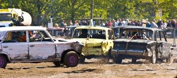 Demolition Derby. Three cars in a demolition derby royalty free stock photo