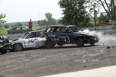 Demolition derby. Napierville demolition derby, July 12, 2015, picture of wrecked and smoking car in action during the demolition derby stock photos