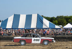 Demolition derby car and crowd Stock Photos
