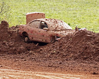Demolition derby car dirt bank Stock Photography