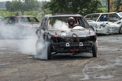 Demolition derby. Napierville demolition derby, July 12, 2015, picture of wrecked car with driver in action during the demolition derby stock images