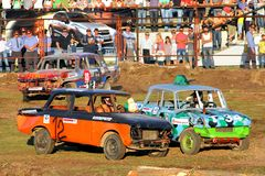 Demolition Derby. UFA, RUSSIA - AUGUST 1: Unidentified competitors' Moskvitch-412 No. 12 and No. 102 take part at the Arena 89 Demolition Derby on August 1, 2012 Royalty Free Stock Image