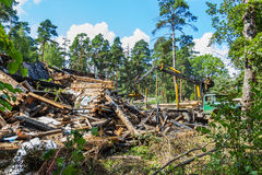 Demolition dismantling of old wooden house. The old house partially burned and dismantled Royalty Free Stock Image