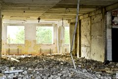 Demolition and dismantling of the remnants of the large industrial enterprise Royalty Free Stock Photo