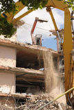 Demolition dust. An office block is turned to dust and rubble as plant machinery destroys the structure Stock Photos