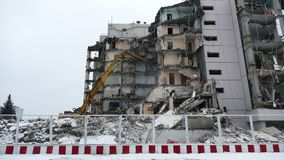 Demolition equipment crunching the concrete at old factory stock footage
