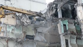 Demolition equipment crunching the concrete at old factory stock video footage
