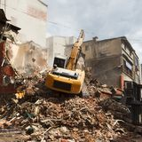 Demolition excavator in the e city Stock Photography
