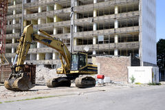 Demolition excavator at the site of a large building Stock Photo