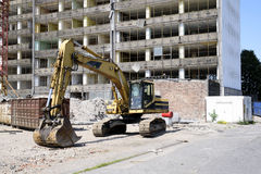 Demolition excavator at the site of a large building Stock Images