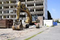 Demolition excavator at the site of a large building Stock Photos