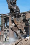 Demolition grapple of an excavator on a construction site during. Demolition work royalty free stock images