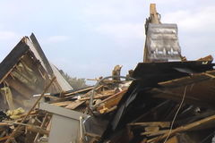 Demolition of a House. A backhoe with steel jaws clears the rubble of a demmolished house stock footage