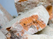 Demolition of house with old bricks. Demolition of house with old red bricks in close-up Stock Photography