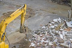 Demolition of an industrial building and drill concrete machine Royalty Free Stock Photos